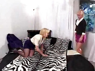 mature fucks her young woman with strapon